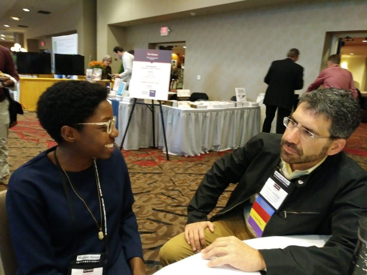 Ngani and Chris Sandvig talking