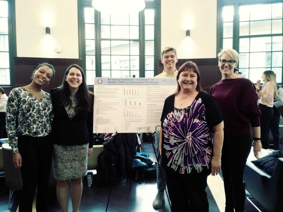 Photo of LIsa Kay and Students with Project Poster