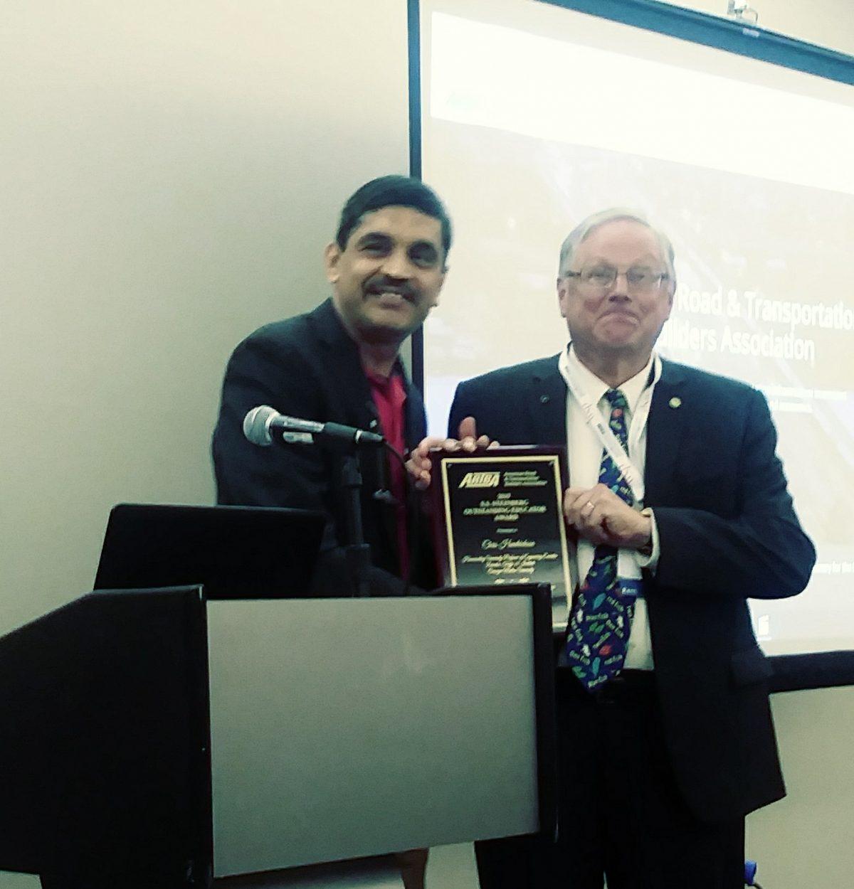 Chris receiving award