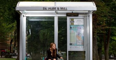 Photo of woman at bus stop